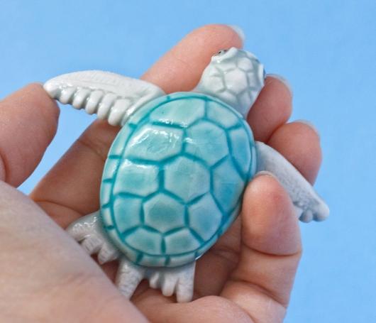 Hatching Turtle (White swimming), $80.00