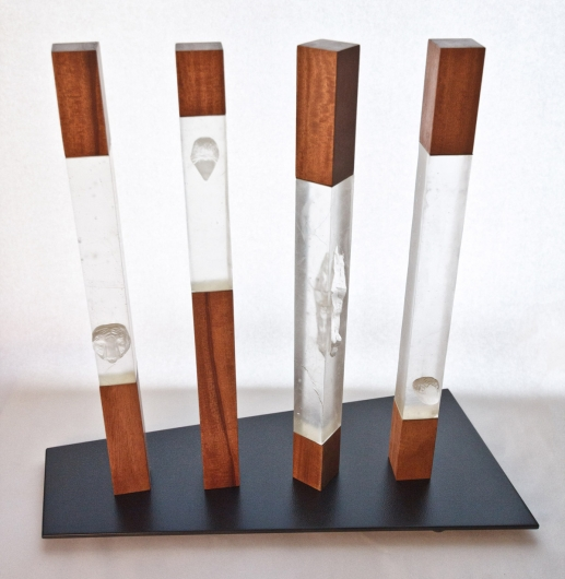 Tuteng, wood and glass sculpture by Emily Miller