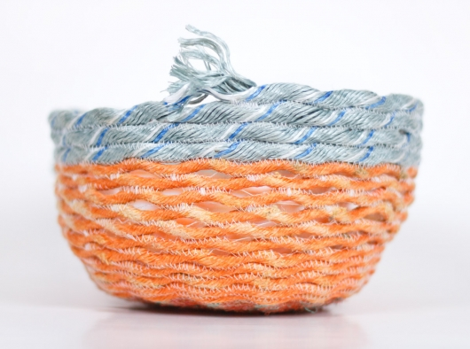 Orange Openwork Basket, Ghost Net Baskets -  artwork by Emily Miller