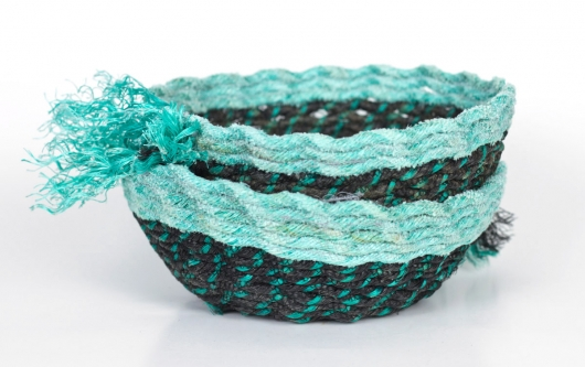 Aqua Lip Black Bowls, Ghost Net Baskets -  artwork by Emily Miller